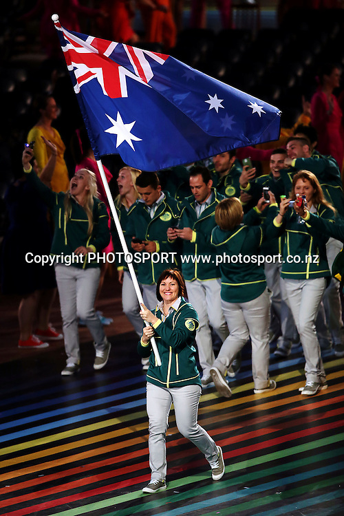 Australia cyclist Anna Meares leads the team into the Stadium. Opening Ceremony of the Glasgow 2014 Commonwealth Games at Celtic Park, Glasgow, Scotland. Wednesday 23rd July 2014. Photo: Anthony Au-Yeung / photosport.co.nz