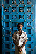 Man at Hindu Temple door. Nagore.