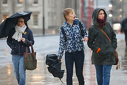 © Licensed to London News Pictures. 07/01/2016. London, UK. Commuters reacting after seeing a flash of lightning in the distance on London Bridge in London on Thursday, 7 January 2016. Photo credit: Tolga Akmen/LNP