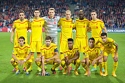 BASEL, SWITZERLAND - Wednesday, October 1, 2014: Liverpool's players line up for a team group photograph before the UEFA Champions League Group B match against FC Basel at the St. Jakob-Park Stadium. Back row L-R: Jose Enrique, Dejan Lovren, goalkeeper Simon Mignolet, Martin Skrtel, Mario Balotelli, Jordan Henderson. Front row L-R: Lazar Markovic, captain Steven Gerrard, Raheem Sterling, Javier Manquillo, Philippe Coutinho Correia. (Pic by David Rawcliffe/Propaganda)