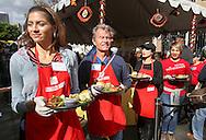 Volunteers serve Thanksgiving meal on Wednesday November 25, 2015, in Los Angeles. Thousands of Skid Row residents and homeless people from downtown and beyond were served Thanksgiving dinners during the Los Angeles Mission's annual holiday feast. (Photo by Ringo Chiu/PHOTOFORMULA.com)<br /> <br /> Usage Notes: This content is intended for editorial use only. For other uses, additional clearances may be required.