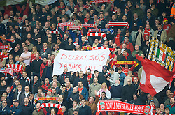 "LIVERPOOL, ENGLAND - Saturday, March 15, 2008: Liverpool fans on the Spion Kop protest against the club's American owners with a banner reading; ""Dubai SOS, Yanks Out"" during the Premiership match against Reading at Anfield. (Photo by David Rawcliffe/Propaganda)"