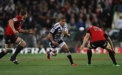 Juan De Jongh of the Stormers looks for the gap between Crusaders lock Sam Whitelock and Crusaders centre Sonny Bill Williams during the Super Rugby Semi-Final match between DHL Stormers and the Crusaders held at DHL Newlands Stadium in Cape Town, South Africa on 2 July 2011...Photo by Shaun Roy / Sportzpics.net