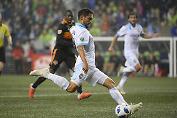 October 8, 2018 - Seattle, Washington, U.S - Seattle's CRISTIAN ROLDAN (7) shoots and scores on an assist from NICO LODEIRO as the Houston Dynamo visits the Seattle Sounders in a MLS match at Century Link Field in Seattle, WA. Seattle won the match 4-1. (Credit Image: © Jeff Halstead/ZUMA Wire)