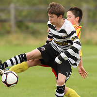 Ciaran Buckley Moher Celtic & Maurice Nugent Avenue United in a battle for possession during their U13 Cup Final. - Photograph by Flann Howard