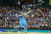 Rohit Sharma smashes one over mid-on for six. T20 international, Australia v India. Sydney Cricket Ground, NSW, Australia, 25 November 2018. Copyright Image: David Neilson / www.photosport.nz