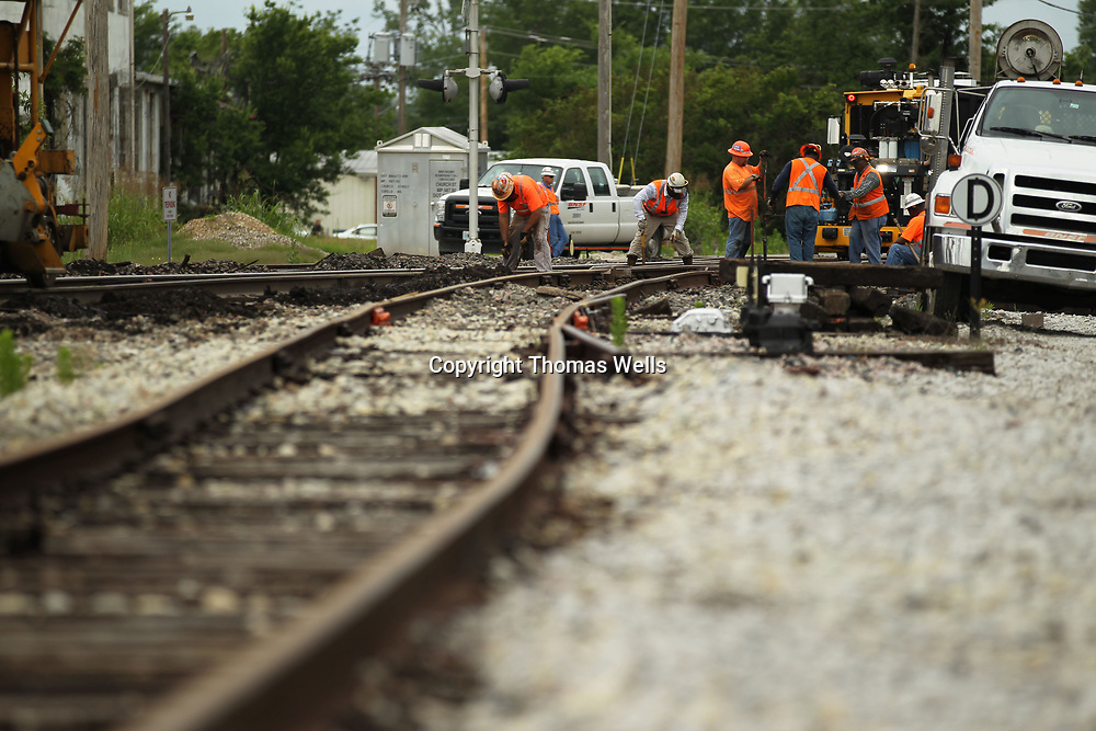 Workers with Burlington Northern Santa Fe continue replacing cross-ties at the South Church Street crossings on Monday as part of their maintaince of the tracks.