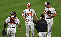 August 31, 2017 - Baltimore, MD, USA - Baltimore Orioles manager Buck Showalter, bottom right, relieves starting pitcher Jeremy Hellickson, middle, after he gave up the lead to the Toronto Blue Jays in the fifth inning at Oriole Park at Camden Yards in Baltimore on Thursday, Aug. 31, 2017. The Blue Jays won, 11-8. (Credit Image: © Kenneth K. Lam/TNS via ZUMA Wire)