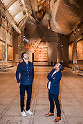 Double Space for BMW by Barber + Osgerby -<br /> Leading design duo, Edward Barber and Jay Osgerby (both pictured) worked with BMW to present a kinetic, silvered structure which is suspended from the ceiling of the Raphael Gallery at the V&amp;A. The installation rotates to create a 'beguiling' reflection of the room, the art and the viewers on the ground. <br /> The London Design Festival at the V&amp;A, South Kensington, London 12 Sept 2014. Guy Bell, 07771 786236, guy@gbphotos.com