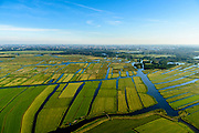 Nederland, Noord-Holland, Gemeente Landsmeer, 13-06-2017; Ilperveld, natuurgebied, gezien richting Landsmeer, Amsterdam-Noord aan de horizon. Waterrijk veenweidegebied met onder andere grasland, riet, veenmos en moerasbos.<br /> Ilperveld, nature area immediately north of Amsterdam.<br /> luchtfoto (toeslag op standard tarieven);<br /> aerial photo (additional fee required);<br /> copyright foto/photo Siebe Swart