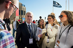 © Licensed to London News Pictures. 30/09/2015. Brighton, UK. Labour shadow chancellor JOHN MCDONNELL being confronted by a group of your women and men about the party choice to vote against military action against the Assad Syrian regime. Day four of the 2015 Labour Party Conference, held at the Brighton Centre in Brighton, East Sussex. This years conference takes place just weeks after Jeremy Corbyn was elected leader of the party. Photo credit: Ben Cawthra/LNP
