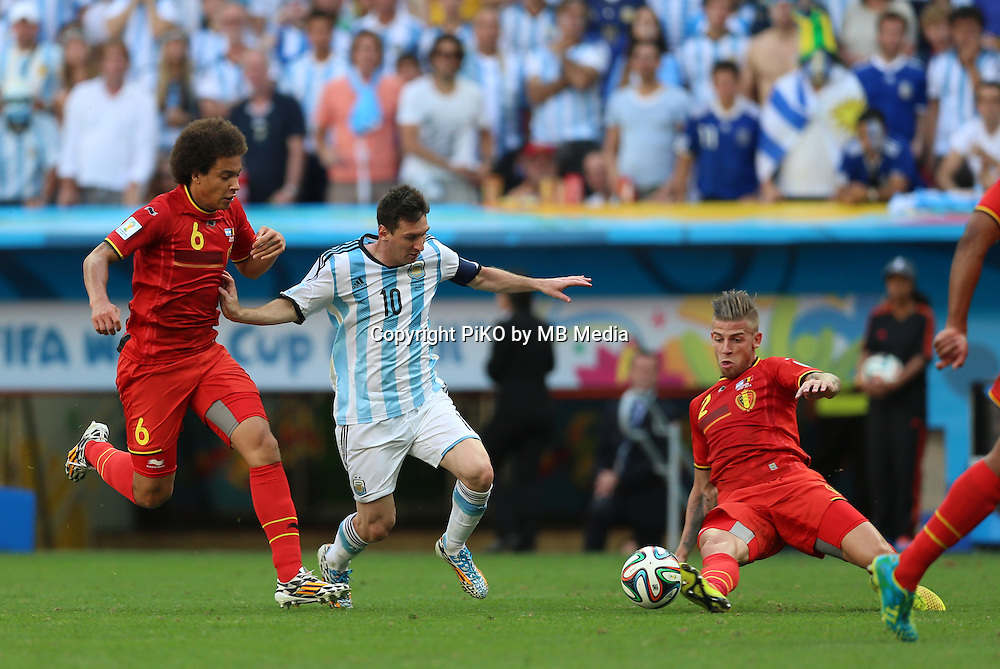 Fifa Soccer World Cup - Brazil 2014 - <br /> ARGENTINA (ARG) Vs. BELGIUM (BEL) - Quarter-finals - Estadio Nacional Brasilia -- Brazil (BRA) - 05 July 2014 <br /> Here Argentine player Lionel Messi between Belgians Axel WITSEL (L) and Toby ALDERWEIRELD (R)  <br /> &copy; PikoPress