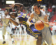 "Mississippi's Marshall Henderson (22) is called for charging against LSU's Andre Stringer (10) at the C.M. ""Tad"" Smith Coliseum in Oxford, Miss. on Wednesday, January 15, 2013. Ole Miss won 88-74 in overtime. (AP Photo/Oxford Eagle, Bruce Newman)"
