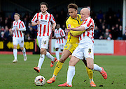 Matt Richards battles with Bobby Reid during the Sky Bet League 2 match between Cheltenham Town and Plymouth Argyle at Whaddon Road, Cheltenham, England on 28 March 2015. Photo by Alan Franklin.