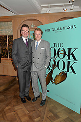 Left to right, EWAN VENTERS and TOM PARKER BOWLES at a party hosted by Ewan Venters CEO of Fortnum & Mason to celebrate the launch of The Cook Book by Tom Parker Bowles held at Fortnum & Mason, 181 Piccadilly, London on 18th October 2016.