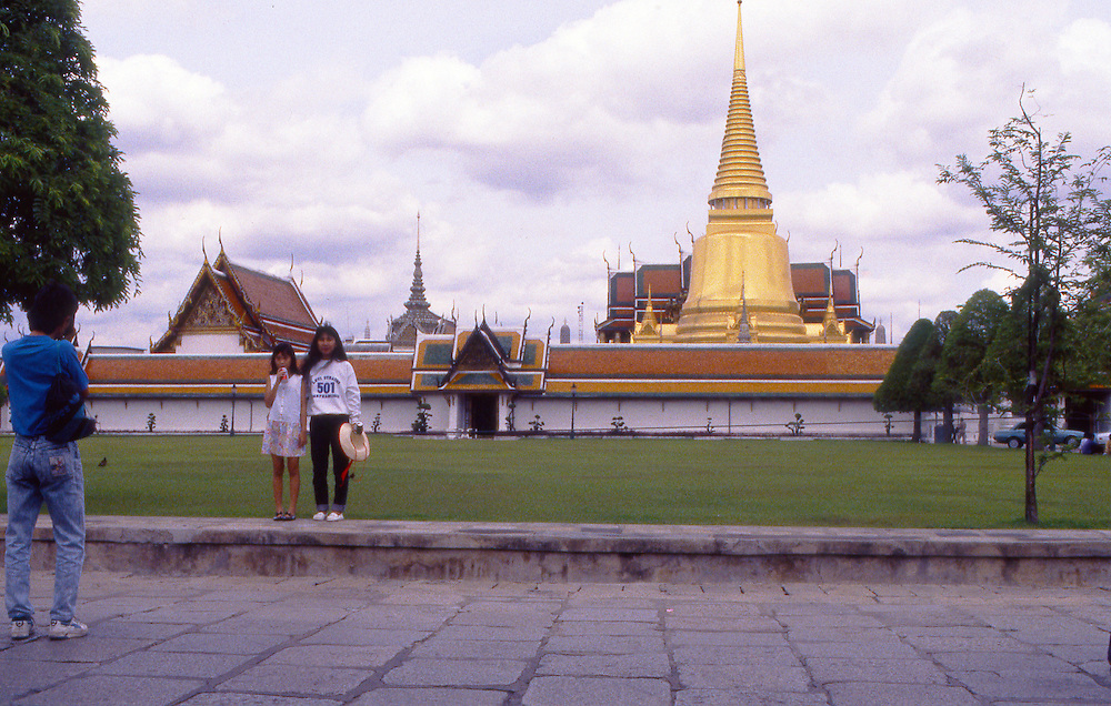 Tourists outside the The Royal Palace, Bangkok, Thailand.