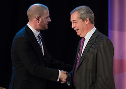 © Licensed to London News Pictures. 28/11/2016. London, UK. Nigel Farage (R) shakes hands with UKIP Party Chairman Paul Oakden as Paul Nuttall is announced as the new leader of the UK Independence Party (UKIP), at the Emmanuel Centre in Westminster London. Photo credit: Peter Macdiarmid/LNP