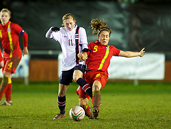 NEWTOWN, WALES - Friday, February 1, 2013: Wales' Danielle Oates in action against Norway's Mia Voltersvik during the Women's Under-19 International Friendly match at Latham Park. (Pic by David Rawcliffe/Propaganda)