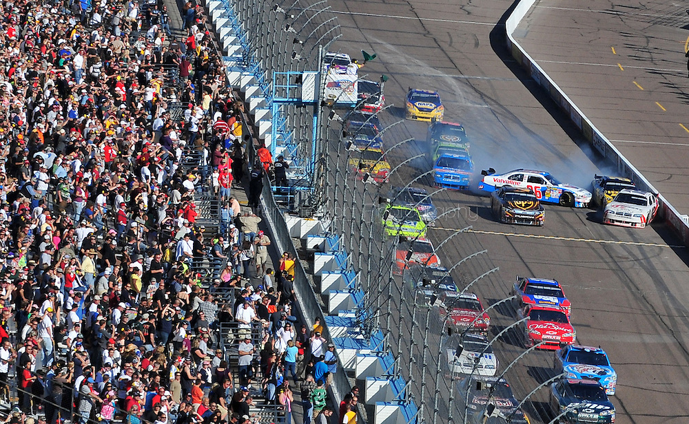 Nov. 15, 2009; Avondale, AZ, USA; NASCAR Sprint Cup Series driver Erik Darnell (96), Jamie McMurray (26), and Brad Keselowski (12) crash during the Checker O'Reilly Auto Parts 500 at Phoenix International Raceway. Mandatory Credit: Jennifer Stewart-US PRESSWIRE