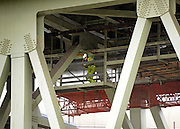 © Licensed to London News Pictures. 09/07/2012. London, UK Construction workers and scaffolding underneath the M4 motorway today 9th July 2012. The M4 has been closed between junctions 1 and 3 after a crack was found in a 'sensitive area' of an elevated section of the motorway. The M4, part of the Olympic Route Network, will be vital for transporting visitors into the city from Heathrow Airport. Photo credit : Stephen Simpson/LNP