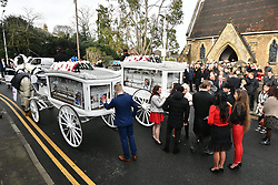 """© Licensed to London News Pictures. 13/02/2020. Sevenoaks, UK. The coffins and mourners leave St John the Baptist church in Sevenoaks, Kent following the funreal service of traveller brothers Billy and Joe Smith. The twin brothers, who were made famous by the television programme """"My Big Fat Gypsy Wedding"""", were found hanged in woodland three days after Christmas. Photo credit: Ben Cawthra/LNP"""