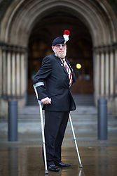 © Licensed to London News Pictures . 08/11/2015 . Manchester , UK . Corporal KEN BLORE (56) (retired) (correct) , from Eccles , who served 38 years in the Royal Regiment of Fusiliers . Remembrance Sunday service at the Cenotaph in Manchester . Photo credit : Joel Goodman/LNP