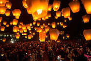 "In Pingsi, Taiwan, thousands of people release ""Sky Lanterns"" on the 15th day of the new lunar year.  With the launcher's hopes and dreams written on the lantern, it is said that the higher the lantern goes, the closer it will come to God, and the better the chances that the wish will come true."