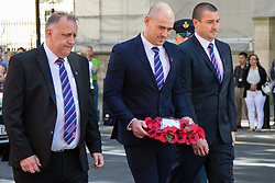 Whitehall, London, August 28th 2015.  Six wreaths are laid at the Cenotaph by representatives from the Armed Forces, the RFL, the Parliamentary Rugby League Group and Ladbrokes Challenge Cup finalists Hull Kingston Rovers and Leeds Rhinos, ahead of Saturday's Ladbrokes Challenge Cup Final at Wembley. PICTURED: Hull KR's representatives including Chief Executive Mike Smith (L) and club captain Terry Campese (C) lay their wreath.