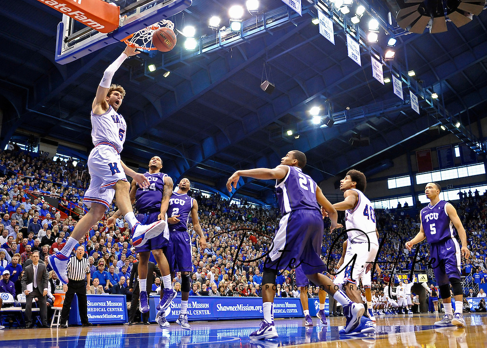Fox Sports -- Kansas Jayhawks center Jeff Withey (5) drives in for a dunk against Texas Christian Horned Frogs forward Adrick McKinney (24) during the first half at Allen Fieldhouse. Kansas defeated Texas Christian 74-48.