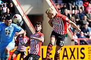 Exeter City's Jayden Stockley goes close with a headed shot during the Sky Bet League 2 match between Exeter City and Morecambe at St James' Park, Exeter, England on 30 April 2016. Photo by Graham Hunt.