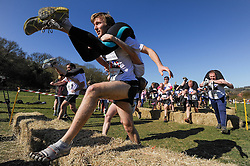 © Licensed to London News Pictures. 16/03/2014. Dorking, UK. The 7th UK Wife Carrying Race. Males or females carry a 'wife' over a 380M course which features obstacles and water hazards. The wives must be at least 18yrs old, male or female and weigh at least 50kg. The last placed finishers receive a ceremonial Pot Noodle and dog food.. Photo credit : Julie Edwards/LNP