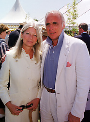 MR & MRS BRYAN MORRISON he is the leading polo figure, at a polo match in West Sussex on 18th July 1999.MUH 35