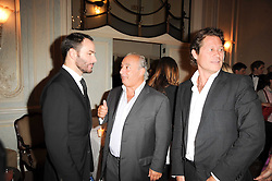 Left to right, TOM FORD, SIR PHILIP GREEN and ARKI BUSSON at a dinner hosted by Vogue in honour of photographer David Bailey at Claridge's, Brook Street, London on 11th May 2010.