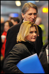 Transport Secretary Justine Greening getting on a train with former Transport Secretary Philip Hammond, Monday January 9, 2012. It was announced today that Phase one of high-speed rail line gets go-ahead. Photo By Andrew Parsons/ i-Images