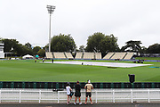 Cricket fans look on ahead of the start of play on Day 1 of the 3rd Test match between the New Zealand Black Caps and the South Africa Proteas. International Test match cricket played at Seddon Park, Hamilton, New Zealand on Saturday 25 March 2017.  Copyright photo: Bruce Lim / www.photosport.nz