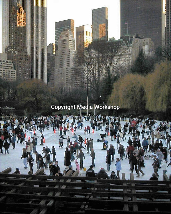 Crowded ice-skating rink at southern end of New York's Central Park.