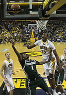 February 2 2011: Michigan State Spartans guard Kalin Lucas (1) and Iowa Hawkeyes forward Devon Archie (35) battle for a rebound as Iowa Hawkeyes forward Andrew Brommer (20) looks on during the first half of an NCAA college basketball game at Carver-Hawkeye Arena in Iowa City, Iowa on February 2, 2011. Iowa defeated Michigan State 72-52.