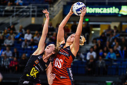 Ellie Bird of the Tactix gets a ball from Katherine Levien of the Magic during the ANZ Premiership Netball match, Tactix V Magic, Horncastle Arena, Christchurch, New Zealand, 6th June 2018.Copyright photo: John Davidson / www.photosport.nz