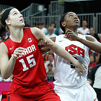 07 August 2012: Canada Michelle Plouffe vies for the rebound with USA Asjha Jones during 91-48 Team USA victory over Team Canada, during the women's basketball quarter-finals, at the Basketball Arena, in London, Great Britain.