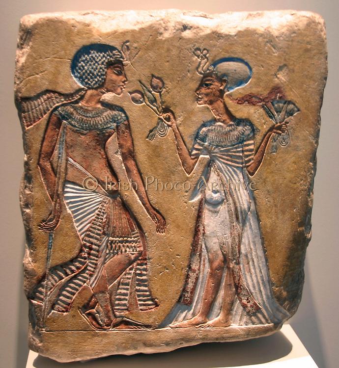 Akhenaten (reigned 1353-1336 BC) and Nefertiti (c1370 BC-c1330 BC) Great Royal Wife  of the Egyptian Pharaoh Akhenaten. Relief in the Egyptian Museum in the Altes Museum Berlin.
