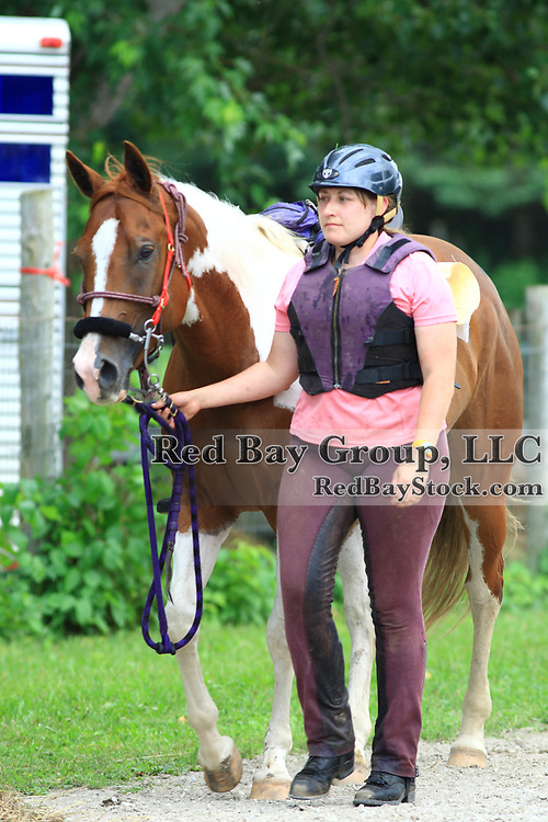 Lysanne Cree with Mae West Holliday at the FEI Sanctioned Endurance ride at the OCTRA Provincial Championships, New Lowell, Ontario, Canada