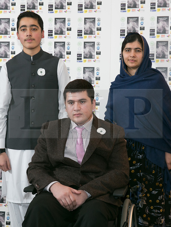 © Licensed to London News Pictures. 15/12/2015. Birmingham, UK. Malala Reception. Pictured, Malala Yousafzai with brothers, Ahmad Nawaz and seated Muhammad Ibrahim. One year on from the tragedy of the Taliban attack on the Army Public School (APS) Peshawar, Nobel Prize winner and teenage activist, Malala Yousafzai and her family hosted a special reception to mark the anniversary of one of the deadliest terrorist attacks in Pakistan.The commemorative reception held today was attended by Ahmad Nawaz and Muhammad Ibrahim Khan, two of the young survivors of the tragedy, along with Malala Yousafzai, the peace and education activist, who has made Birmingham her adopted home. As part of the commemorative ceremony, members of the public are being asked to wear a white poppy, representing the global mark of peace. Photo credit : Dave Warren/LNP