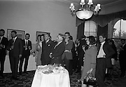 13/07/1967<br /> 07/13/1967<br /> 13 July 1967<br /> International TV award for Kenny's  Advertising Agency Ltd. presented at the Shelbourne Hotel, Dublin. At a reception in the Shelbourne Mr. James Van Buren, of Time Life International, presented the International Market Advertising award, won against competition from 15 countries, to Mr. Michael B. Kenny and Mr. K.A. Kenny, Joint managing directors of Kenny's Advertising. the award, won by Kenny's for the second successive year, was for a 30-sec. television commercial made for Navan Carpets and shown on RTE. <br /> Picture shows a view of the reception, man with pipe is Mr. Allan Mallinson, managing director of Navan Carpets Ltd.