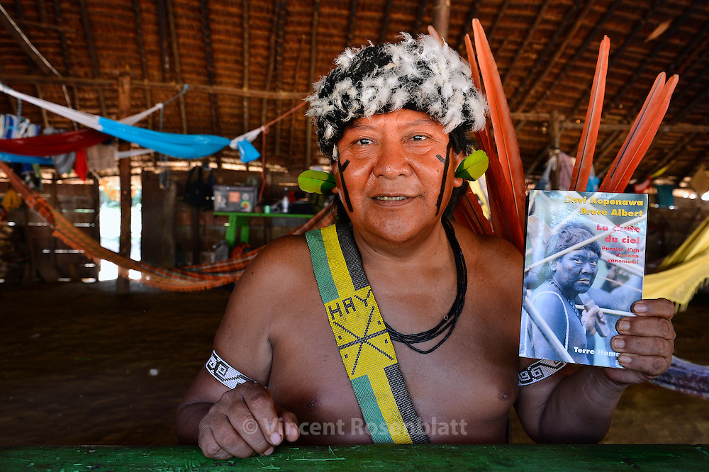 Davi Kopenawa - most famous indigenous leader of Brazil shows his book co-written with anthropologist Bruce Albert (ed. La Chûte du ciel Terre Humaine, France). President of Hutukara - Yanomami association - reelected in 2012. In his village of Watoriki.