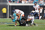 JACKSONVILLE, FL - DECEMBER 12:  Linebackers Brian Urlacher #54 and Lance Briggs #55 of the Chicago Bears gang tackle running back Fred Taylor #28 of the Jacksonville Jaguars on December 12, 2004 at Alltel Stadium in Jacksonville, Florida. The Jags defeated the Bears 22-3. ©Paul Anthony Spinelli *** Local Caption *** Brian Urlacher;Lance Briggs;Fred Taylor