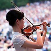 July 17, 2012 - New York, NY : Violinist Na Sun, foreground, and the New York Philharmonic perform Richard Wagner's 'Prelude to Act I of Die Meistersinger (1862-67)' in Central Park on Monday evening.  CREDIT: Karsten Moran for The New York Times