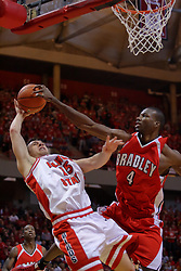 "31 January 2009: Sead Odzic takes it up strong against 7 footer David Collins.  Collins gets the ball clean, but gets called for a body foul. The Illinois State University Redbirds join the Bradley Braves in a tie for 2nd place in ""The Valley"" with a 69-65 win on Doug Collins Court inside Redbird Arena on the campus of Illinois State University in Normal Illinois"