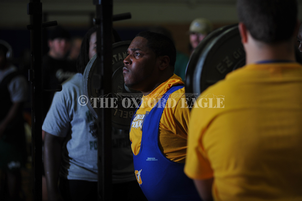 Challin Griffin squats during Class 5A Region weightlifting competition at Oxford High School in Oxford, Miss. on Saturday, February 9, 2013.