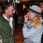NLD/Amsterdam/20130325 - High Fashion Tea Jos Raak 2013, Jos in gesprek met de moeder van Bridget Maasland