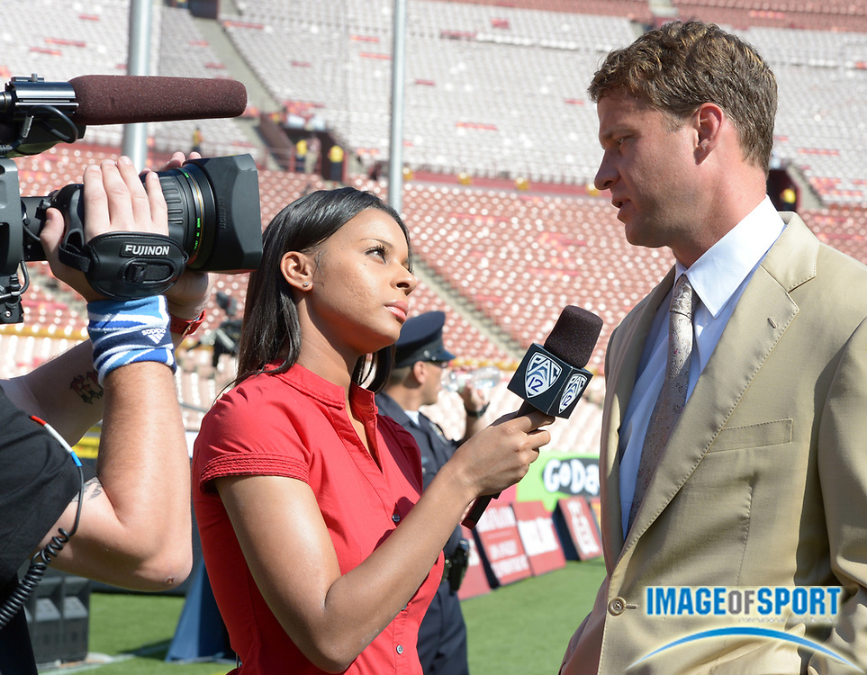 Sep 14, 2013; Los Angeles, CA, USA; Pac-12 Network sideline reporter Drea Avent (left) interviews Southern California Trojans coach Lane Kiffin before the game against the Boston College Eagles at Los Angeles Memorial Coliseum.